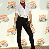 In 2007, Gwen Stefani punched up a black-and-white look with a tartan scarf.