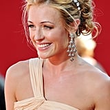 A bohemian updo worn by Cat Deelery to the 2009 Emmy Awards was lifted with a jewelled daisy chain wrapped around the back of the head.