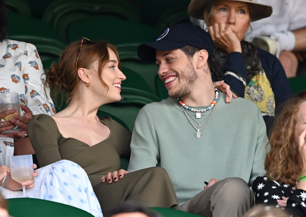 """Game, set, they're a match! On Saturday, Pete Davidson and Phoebe Dynevor made their official public debut as a couple while attending day six of the Wimbledon Tennis Championship, and they kept cuddled up for the entire event. Look closely, and you can spot Pete wearing the """"PD"""" necklace they both share. If that isn't cute, we don't know what is.  Phoebe and Pete have been linked ever since they first sparked relationship rumours in March. According to Entertainment Tonight, the duo hit it off when they met in New York City. Now the Saturday Night Live star and Bridgerton leading lady are taking their love across the pond. Get a look at their sweet outing in the photos ahead.       Related:                                                                                                           What's It Like Dating Pete Davidson? Here's What His Exes Have Said"""