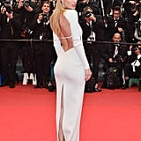 Doutzen Kroes proved the back of her Calvin Klein Collection gown was just as alluring as the front with a revealing cutout and a slit.
