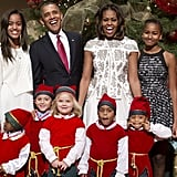 President Barack Obama and First Lady Michelle Obama had a laugh with their family while hanging out with children dressed up as elves.