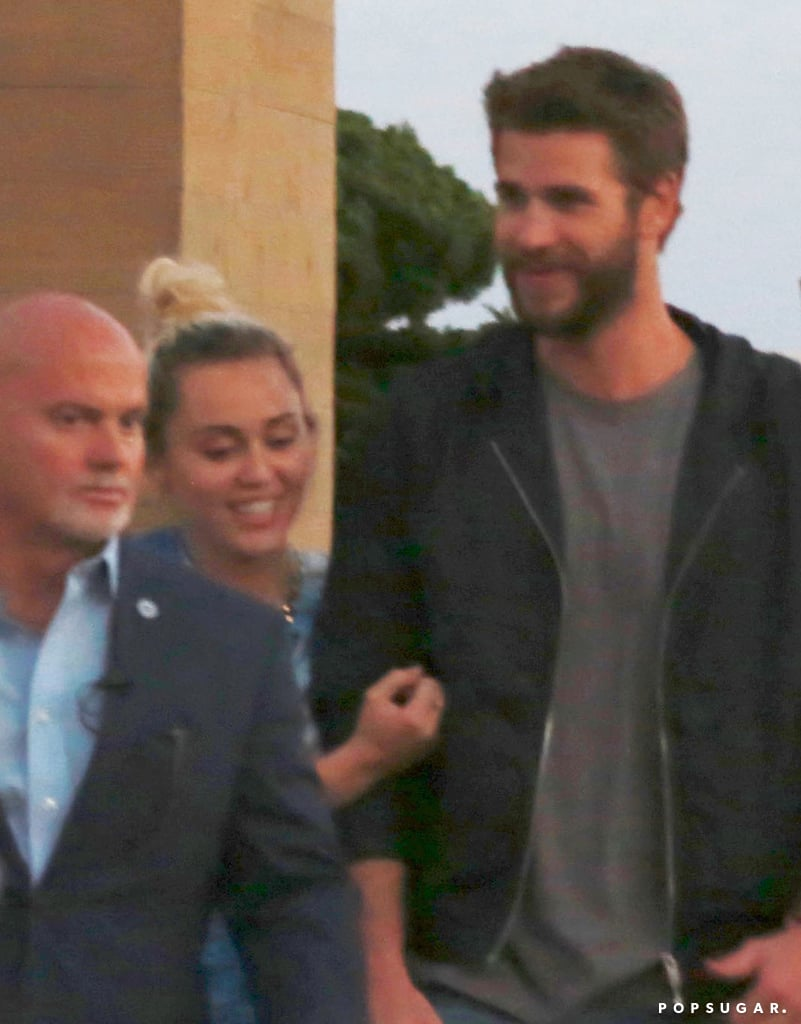 Miley Cyrus and Liam Hemsworth looked as happy as can be following their dinner date at Nobu in Malibu, CA, on Friday evening. Upon leaving the restaurant, Miley and Liam laughed and giggled like two kids in love as they jokingly flipped off photographers and made their way back to their car. Just last month, we saw the pair holding hands during a night out in NYC, and shortly after, Miley took to Instagram to share a photo of herself wearing a tee with Liam's last name written across the back. Read on for more photos, then check out everything we know about Liam and Miley's upcoming nuptials so far!
