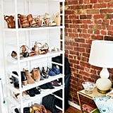 Bookshelves are also a major space saver in any room, particularly the living room. They don't take up a lot of floor space, but they can hold a ton. And if you style them right, they can look sleek and polished. Adding a slim bookshelf to a small corner of your apartment is a great way to store your shoes as well!
