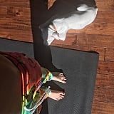 Miley got in some partner yoga with a furry fellow yogini.