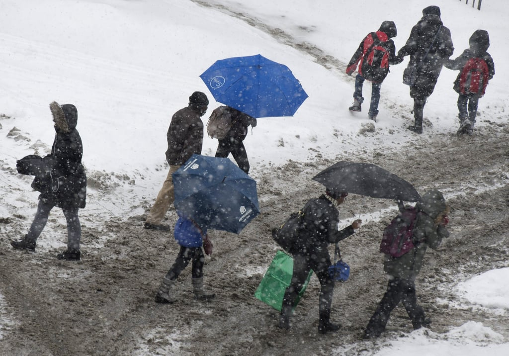 Commuters struggled as they made their way through the NYC snow.
