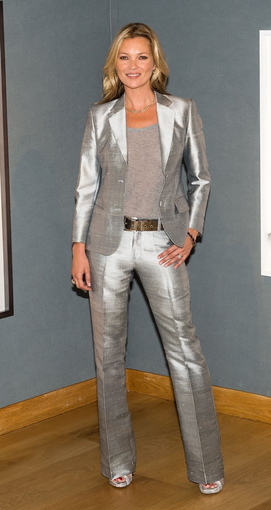 Kate Moss unveiled her Christie's auction in a slim metallic suit.