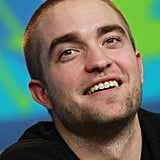 Robert Pattinson cracked a smile at a Berlin press event.
