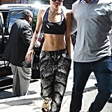 Giving Sporty Spice a run for her money topping printed jogger pants with a two-toned sports bra, a bevy of gold chains, and furry, yes furry, Céline sandals in NYC.