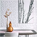 "If a colorful wallpaper is too bold, you can go with a more subtle, textured wall treatment like embossed three-dimensional wall flats ($86). ""These fun and interesting wall flats from Inhabit Living add a great dimension to any space,"" says Bobby, noting the great price value."