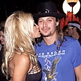 Pamela Anderson planted a kiss on Kid Rock backstage at the VMAs in 2001.