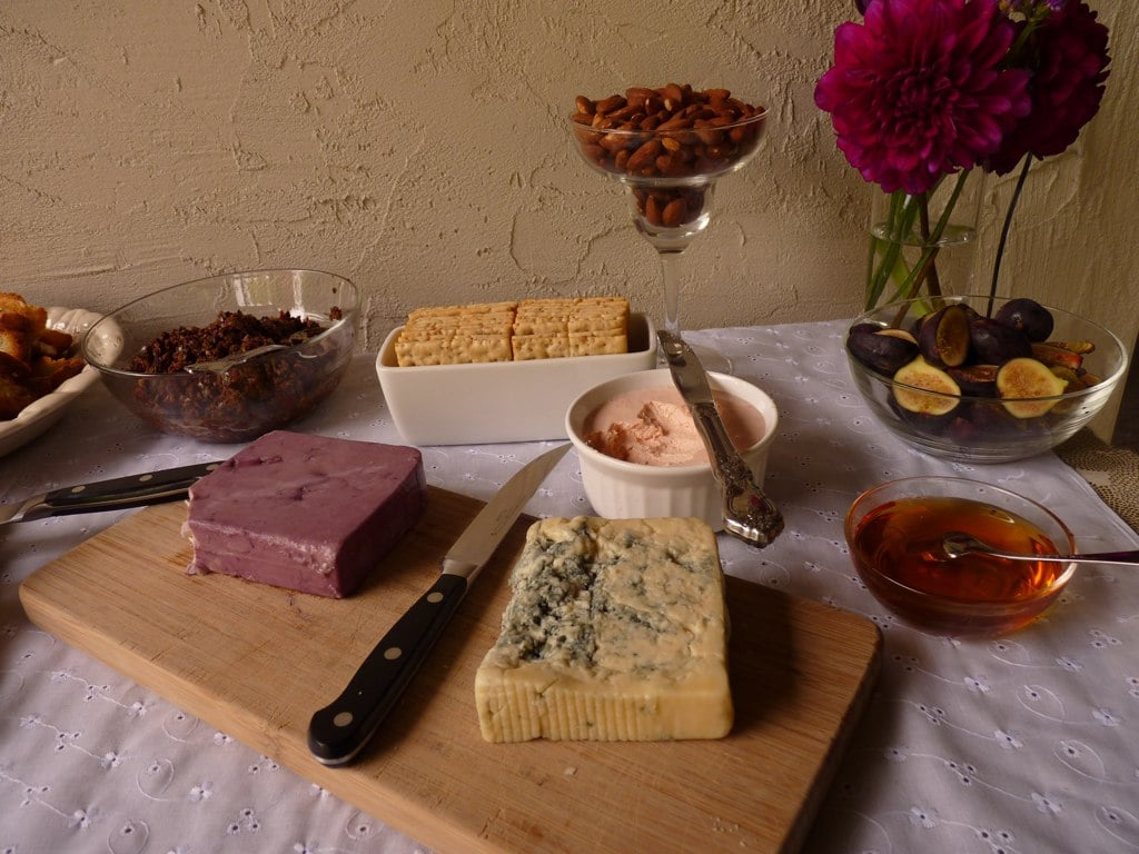 On the left is a cheddar whose rind was washed in wine; on the right is Rogue Creamery's smoky blue. Figs, crackers, smoked salmon mousse, honey, and tapenade round out the decadent spread.