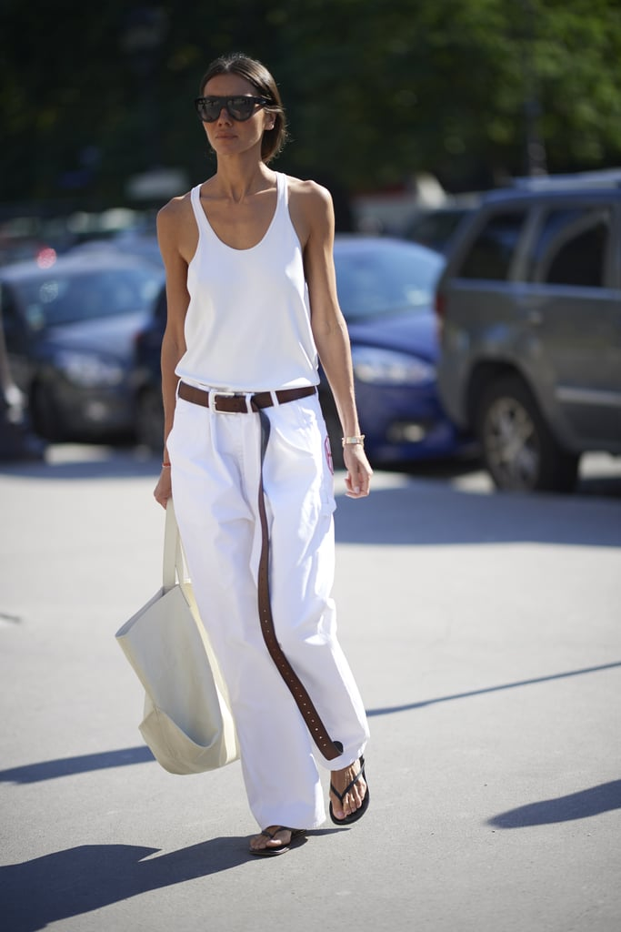 Try Plain Flip-Flops With Baggy White Jeans, a Long Belt, and a Tank