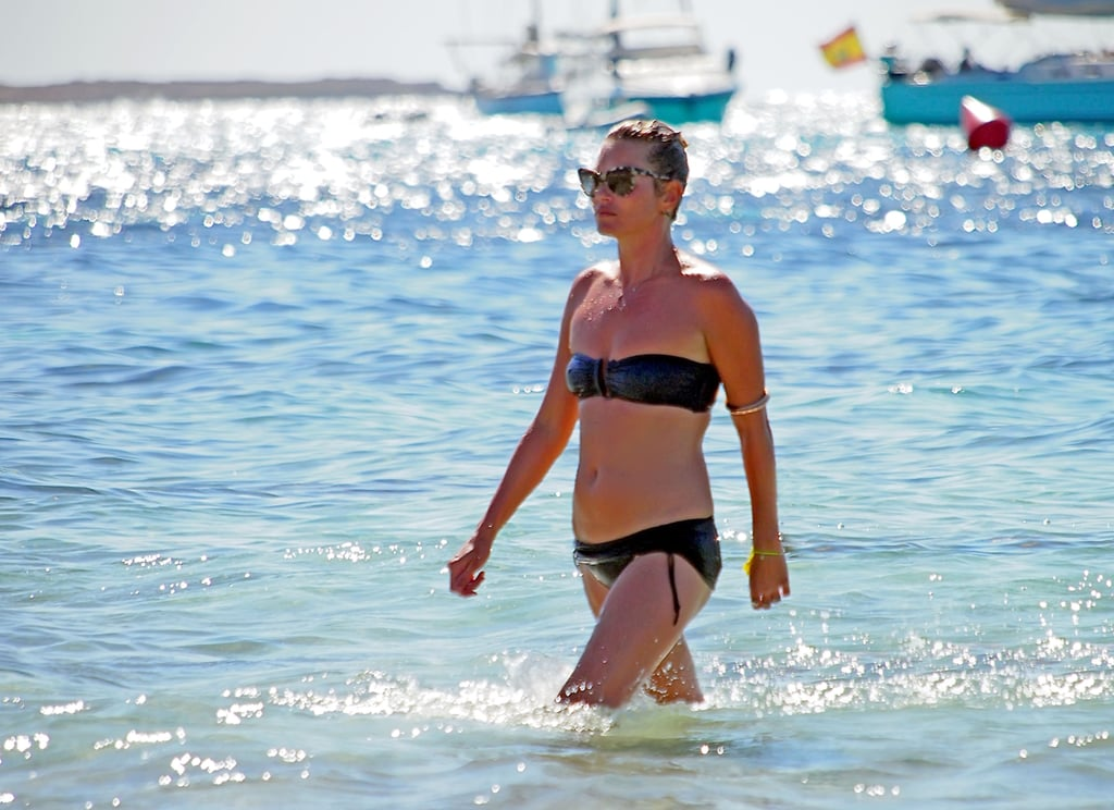Kate Moss wore a black bandeau bikini when she took a dip in the ocean in August in Formentera.