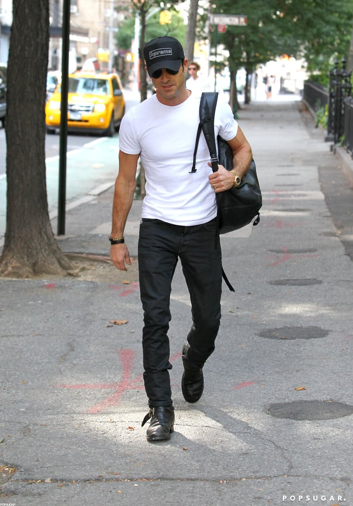 """Justin Theroux grabbed his backpack and put on a Supreme hat for a walk in NYC yesterday. He's been out and about in the Big Apple this week, after his engagement to Jennifer Aniston earlier this month. Justin may be apart from Jennifer while she films We're the Millers in North Carolina, but he's still been celebrating the exciting news. Justin grabbed dinner with friends on Monday night at The Smile in SoHo, where he was reportedly """"beaming."""" Jennifer, meanwhile, worked on a racy scene with costar Jason Sudeikis that had her showing off her stomach in a bra for the cameras."""