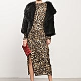 Coyote Black Fur Jacket, Jacquard Leopard Dress, Whisper Black Suede Sandal, TM Enjoy Red Clutch. Photo courtesy of Tamara Mellon