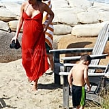 Victoria Beckham pregnant on the beach.