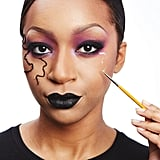 Use a thin liner brush to apply Duo Lash Glue in the pattern you want your veins to flow.