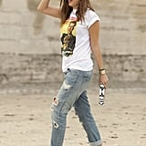 Prada heels and a unique hat made this denim-and-t-shirt look pop.