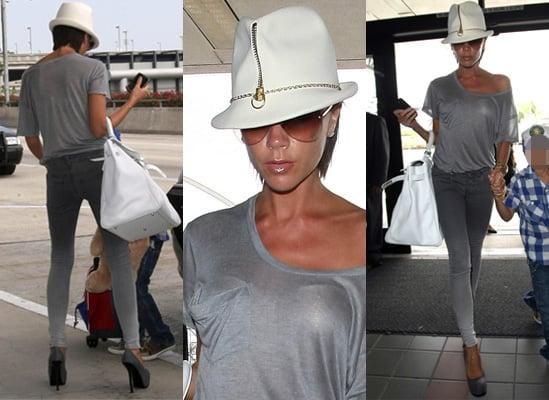Photos of Victoria Beckham at LAX in White Zip Hat