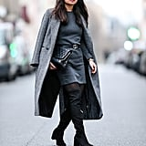 With an All-Grey Look and Black Over-the-Knee Boots