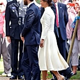 At Princess Charlotte's christening Pippa once again chose a cream color scheme, this time from Emilia Wickstead. The high collar works well on her, as does the similarly retro-flavored textured fabric.