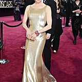 Renée Zellweger sparkled in a gold metallic dress at the Oscars.