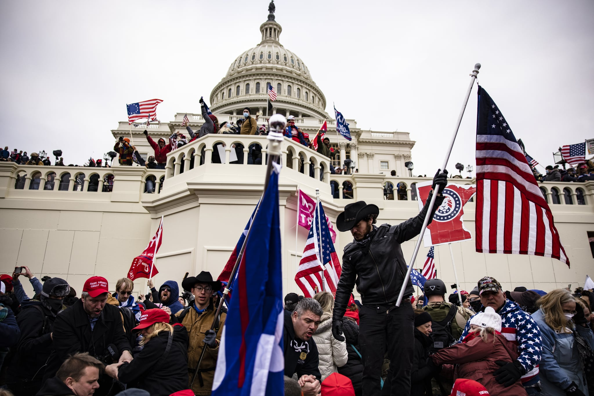 WASHINGTON, DC - JANUARY 06: Pro-Trump supporters storm the U.S. Capitol following a rally with President Donald Trump on January 6, 2021 in Washington, DC. Trump supporters gathered in the nation's capital today to protest the ratification of President-elect Joe Biden's Electoral College victory over President Trump in the 2020 election. (Photo by Samuel Corum/Getty Images)