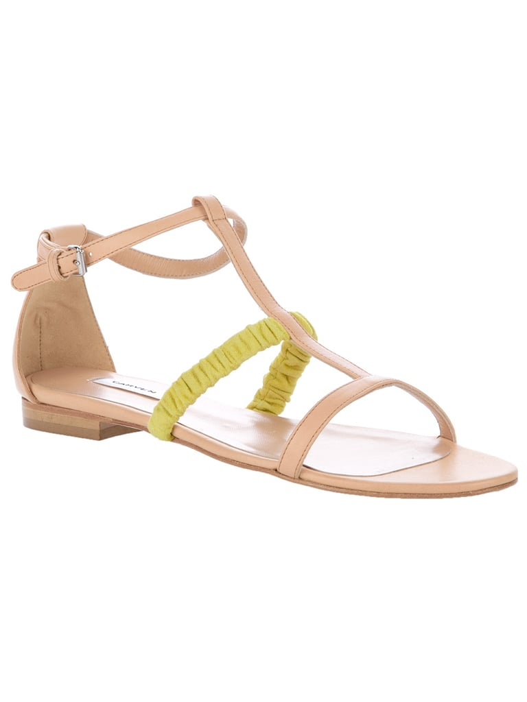 Nude sandals are made infinitely cooler by a thin yellow strap.  Carven Flat Sandals ($514)