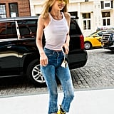 What matches: Gigi's yellow lenses and bright Dr. Martens boots. Gigi toted an adorable Furla zebra bag and wore a tank top with acid-wash denim.