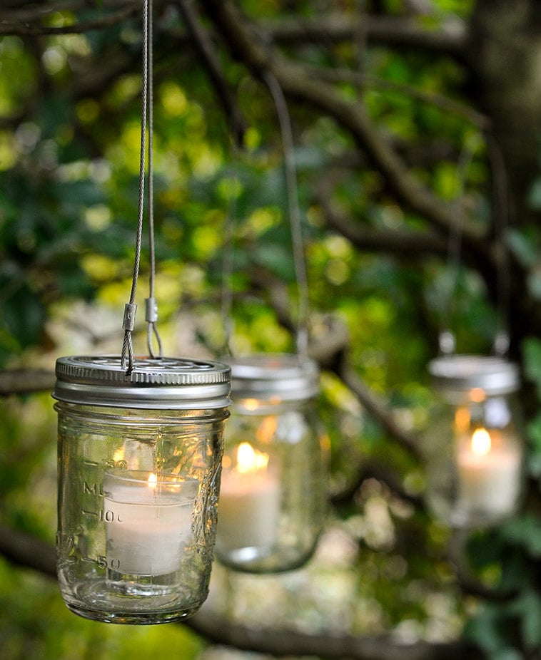 Fill Mason Jars With Tiny Candles And Then Hang Them On
