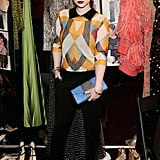 Michelle Trachtenberg struck a pose backstage at the Naeem Khan show.