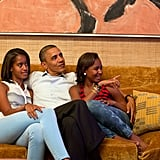 When Barack and the girls snuggled up in front of the TV.