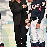Brad Pitt checked out the baseball uniforms on some Japanese players.