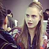 Surprise! Cara Delevingne backstage at Jean Paul Gaultier.