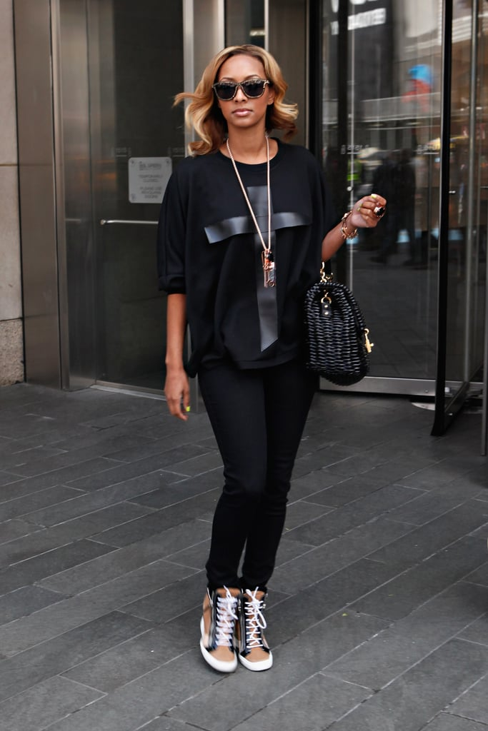 Keri Hilson rocked two-tone high-top Giuseppe Zanotti sneakers with an all-black ensemble.