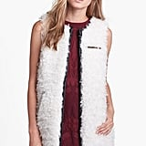 What better way to counter a soft feminine top or dress than with this fuzzy ASTR Faux Leather Trim Vest ($86)?