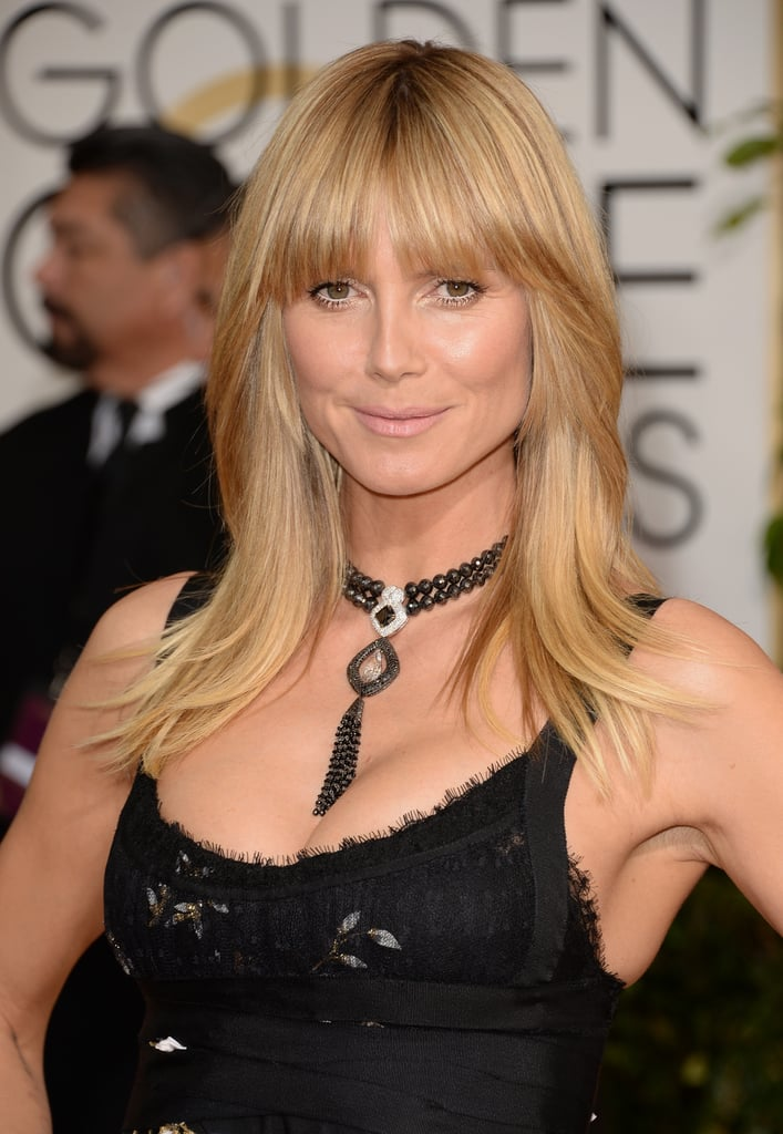 Heidi Klum took a cue from Farrah Fawcett working blunt bangs, flipped strands, and beach-babe makeup.