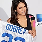 Nina Dobrev showed off her jersey before the traditional celebrity beach bowl game.