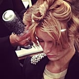 Pin curls kept this Brigitte Bardot-esque style bouncy before the Rachel Zoe presentation.