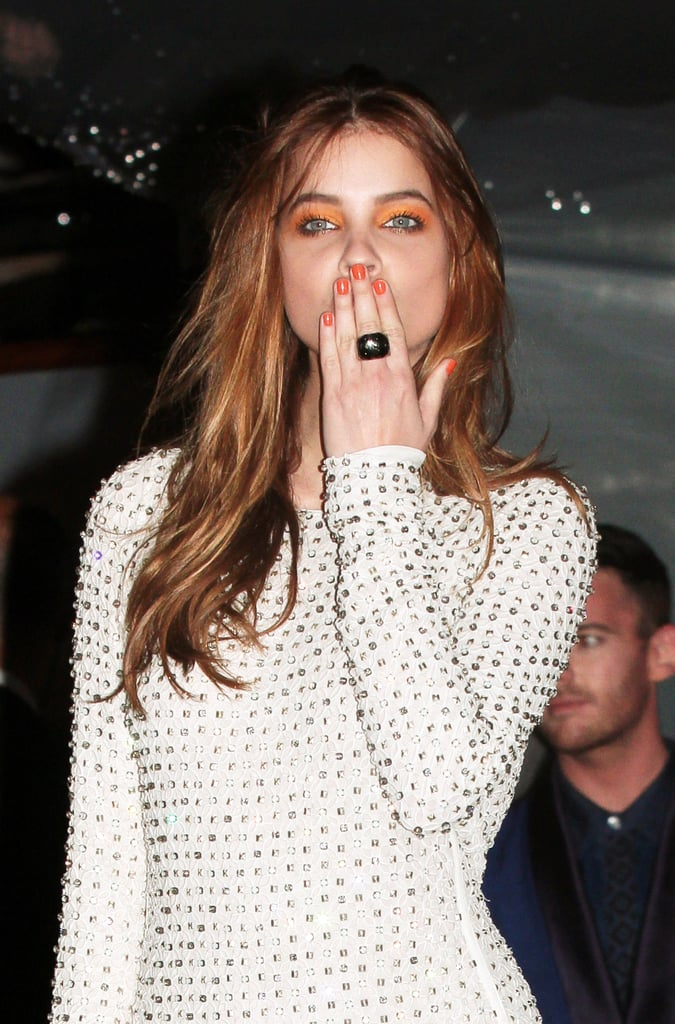 Model Barbara Palvin was in Cannes donning orange nails with bright eye makeup to match. Colour Riche Nail in L'Orange ($6).