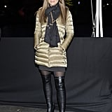Elizabeth Hurley paired thigh-high boots with a gold puffer at the Moncler ice rink presentation.