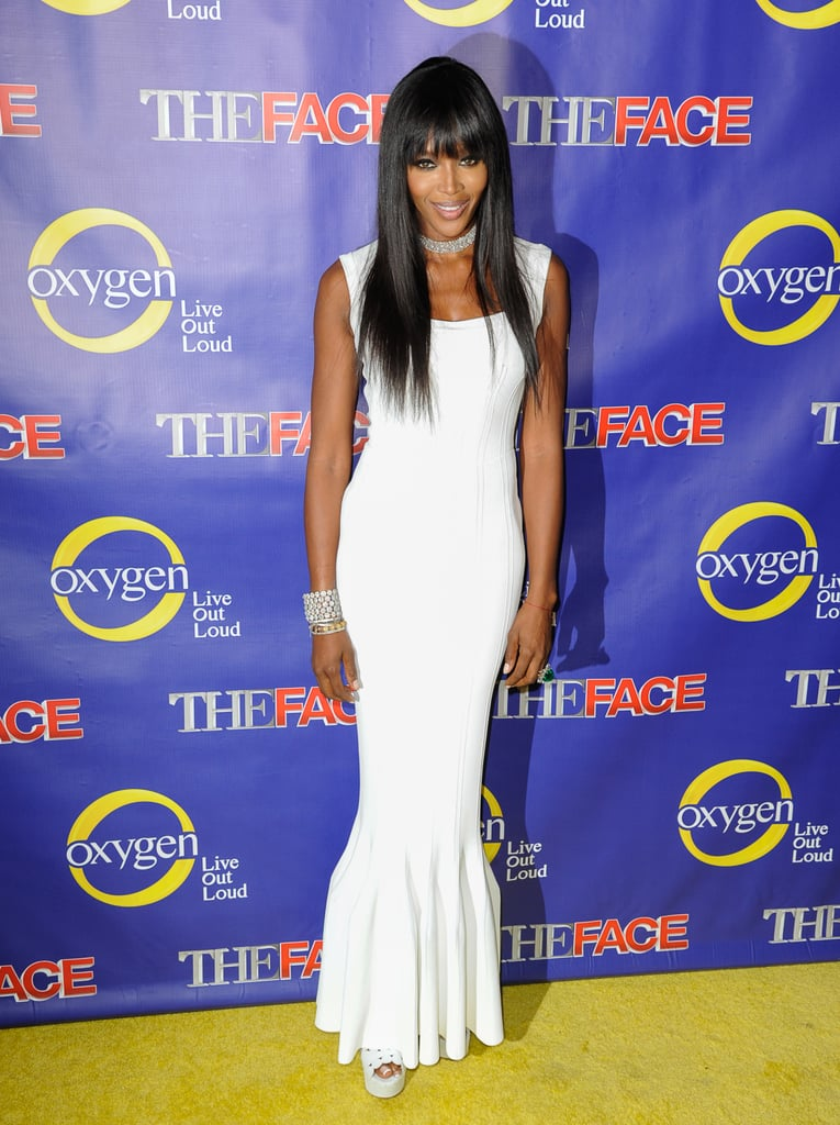 Naomi Campbell showed off her curves in a creamy white Alaïa gown, that she finished with high-wattage jewels and a coordinating pair of Alaïa heels.