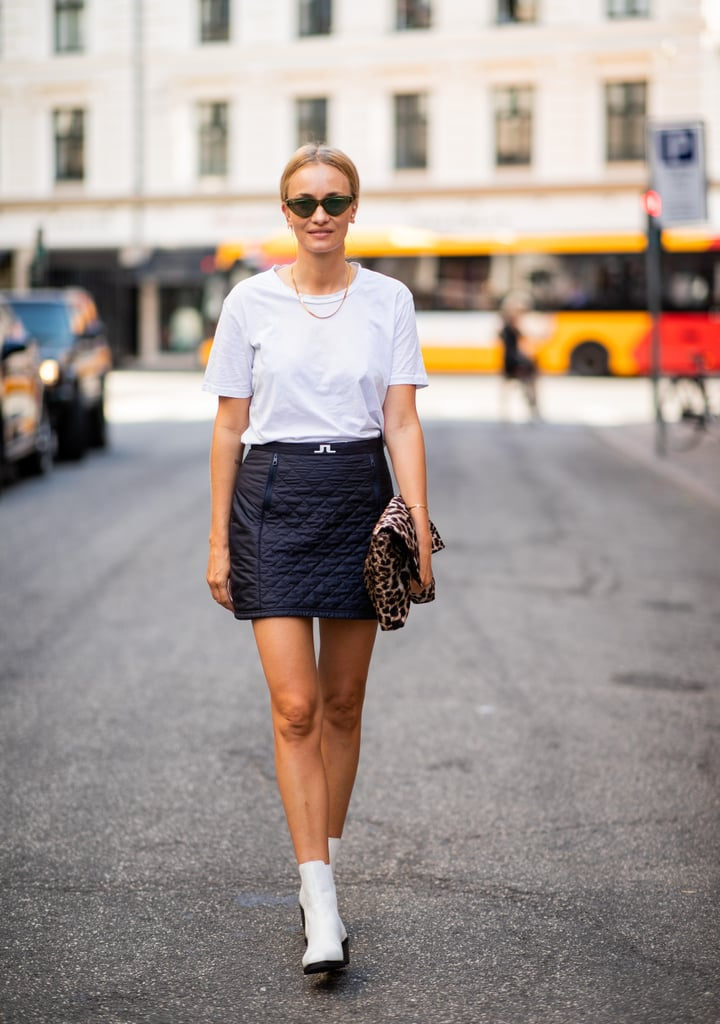 A T Shirt And White Boots Feel Fresh With A Dark Miniskirt Mini