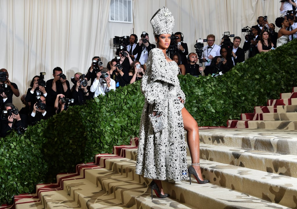"Another year, another fabulous Met Gala is almost here. And as we await the 2019 event, it's time for a trip down memory lane. The theme last year was Heavenly Bodies: Fashion & The Catholic Imagination, and the A-list attendees did not disappoint. From hosts Amal Clooney and a very papal Rihanna to guests Katy Perry, Blake Lively, Kim Kardashian, and Jennifer Lopez, we definitely got our fill of Met Gala magic. Celebrity couples spiced things up with their sexy PDA, and of course, the religious-inspired fashion was completely off the charts.  Inside the event, stars were treated to a cocktail party and dinner, where they mixed and mingled with each other. Nicki Minaj and Cardi B ended their ""feud"" with a sweet interaction, and Gigi Hadid and Selena Gomez shared a hug, despite some potential awkwardness. It was quite a night — can you handle the glamour? We've rounded up the hands-down hottest photos from this year's Met Gala — keep reading to see them all now!      Related:                                                                                                           21 Celebrities Who Attended the Met Gala For the First Time Ever This Year"