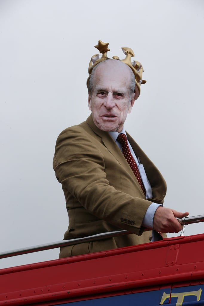 A racegoer wore a Prince Philip mask.