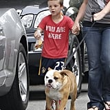 Cruz Beckham tried to keep up with the Beckham family dog, Coco, during an LA walk in June 2011.