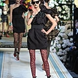 A one shoulder LBD is jazzed up with leopard print tights.
