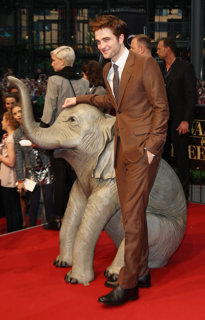 Robert Pattinson changed into a brown suit for the Berlin premiere of Water For Elephants today. He arrived in Germany yesterday and enjoyed dinner with friends before stepping out for a photo call with his costar Christoph Waltz. The duo kicked off overseas press for the film without Reese Witherspoon, though she should be joining them soon since she was spotted catching a flight out of LAX last night. Robert is sporting a bit of a glow from his weekend in the Caribbean working on reshoots for Breaking Dawn, where he stripped down for sexy Edward and Bella honeymoon scenes in skimpy swimsuits.