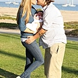 Kevin Federline and Victoria Prince stole a kiss while they held baby Jordan Kay.