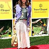 Olivia Palermo put her spin on silky layers, pairing a purple button-up blouse with a sheer gray top and flowy maxi skirt. To boot, she also listed off her three must-have Summer essentials: sunscreen, a sun hat, and her Paul Smith sunglasses.